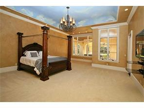 Expansive master suite with custom painted ceiling and large win