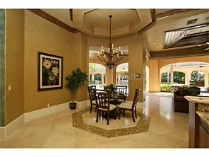 Breakfast nook featuring tray ceiling and handset stone floor wi