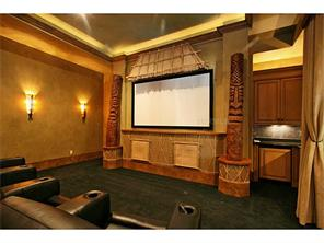 Media room with double tray ceiling, accent lights, wet bar and