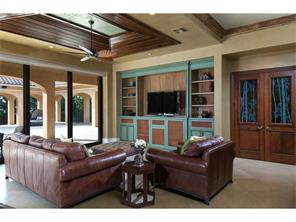 Family Room with custom cabinets, cypress tray ceiling, recessed
